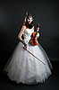 Girl in white dress and mask with violin | Stock Foto