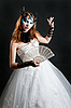 Girl with fan and mask in white dress | Stock Foto