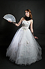 Girl with fan in white dress | Stock Foto