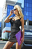 Blonde businesswoman with pink folder | Stock Foto