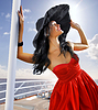 Beautiful woman in red dress on the yacht | Stock Foto
