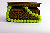 Photo 300 DPI: old wooden box for jewelry and green beads
