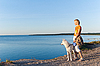 Woman with dog at the sea | Stock Foto