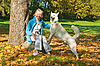 Woman with dog in autumn park | Stock Foto