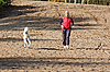 Photo 300 DPI: Running sporty woman with dog