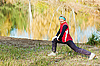 Woman does sports exercises in autumn park | Stock Foto