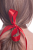 Red bow in hair | Stock Foto