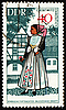 Young woman in national costume on post stamp | Stock Illustration