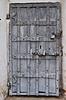 Ancient rusty metal door with padlock | Stock Foto