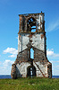 Destroyed bell tower on lake bank | Stock Foto