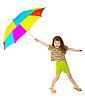 Фото 300 DPI: Маленькая счастливая девушка играет с цветным зонтом
