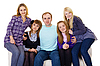 Big family on couch - four women and one man | Stock Foto