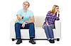 丈夫和妻子在沙发上争吵 | 免版税照片