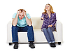 Photo 300 DPI: Nervous husband and wife sitting on couch