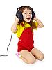 小女孩坐在大听筒 | 免版税照片