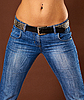 Young woman in jeans - belly and hips | 免版税照片