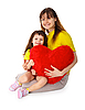 Mom and daughter with toy heart in hands | Stock Foto