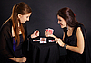 Photo 300 DPI: Two girls friends engaged in fortune-telling cards