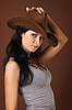 Young sexy woman in cowboy`s hat - portrait | 免版税照片