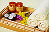 Tray of towels, candles and pebbles - spa | Stock Foto