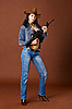 Photo 300 DPI: Young woman in jeans holding rifle