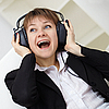 Photo 300 DPI: cheerful woman singing in ear-phones