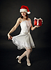 Woman in Christmas cap with celebratory gift | Stock Foto