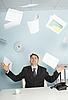 Photo 300 DPI: Bureaucrat - businessman juggling documents