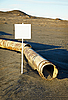 Sign near old rotting pipe - ecological disaster | Stock Foto