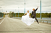 ID 3147474 | Newly married pair jumps on highway | High resolution stock photo | CLIPARTO