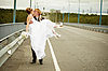 ID 3147527 | Groom carries his bride in his arms on bridge | High resolution stock photo | CLIPARTO