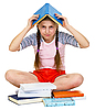 Young girl with book on head | 免版税照片