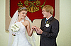Photo 300 DPI: Bride and groom on background of coat of arms