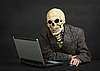 ID 3148779 | Terrible skeleton sits at black office with laptop | Foto stockowe wysokiej rozdzielczości | KLIPARTO