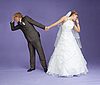 Comical emotional groom and bride holding hands | Stock Foto
