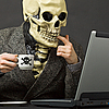 ID 3148917 | Skeleton drinks poisonous coffee at table with laptop | High resolution stock photo | CLIPARTO