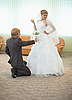 Groom with bride funny pose in hall | Stock Foto