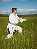Photo 300 DPI: Young man goes in for karate in open air