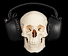 立体声耳机的人类头骨 | 免版税照片
