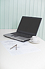 Laptop on table with drawing and compasses | Stock Foto