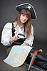 Woman - pirate with sea map and magnifier glass | Stock Foto