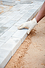 Photo 300 DPI: Installation of brick platform - laying bricks on sand