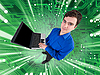 Man with laptop on electronic green board | Stock Foto