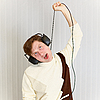 People smothers itself wire of stereo-ear-phones | Stock Foto