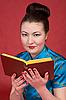 Japanese girl reading book   Stock Foto