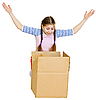 Little girl joyfully looks in box | Stock Foto