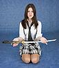 女孩坐在腿上绵延剑 | 免版税照片