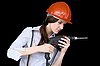 Young woman in protective helmet with drill | 免版税照片