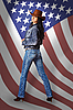 Young woman in jeans with American flag | 免版税照片