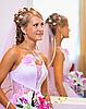 Beautiful bride in pink dress near the mirror | Stock Foto